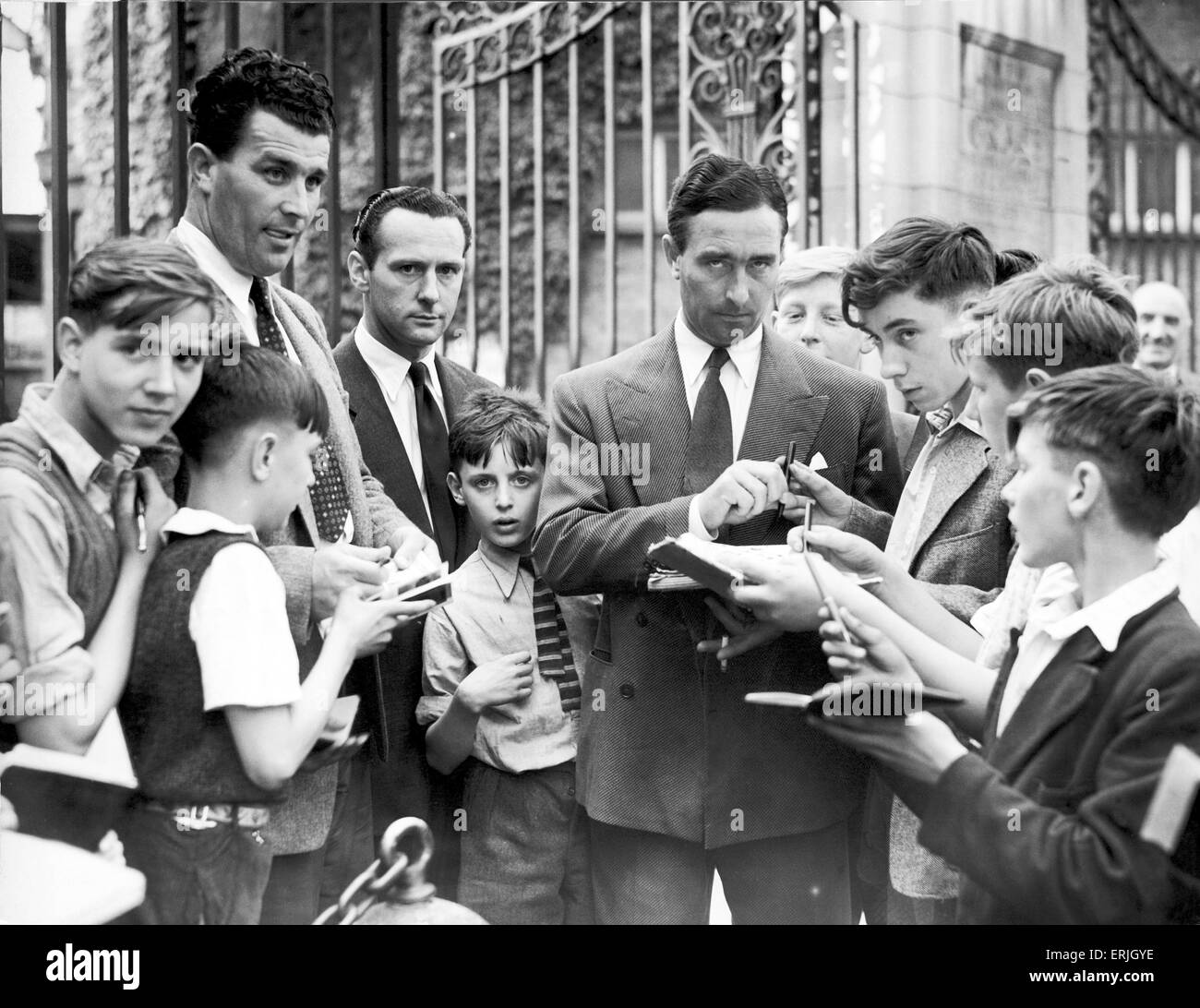 The Compton brothers, Denis and Leslie, beseiged by autograph hunters at Lord's cricket ground. 11th June 1952. - Stock Image