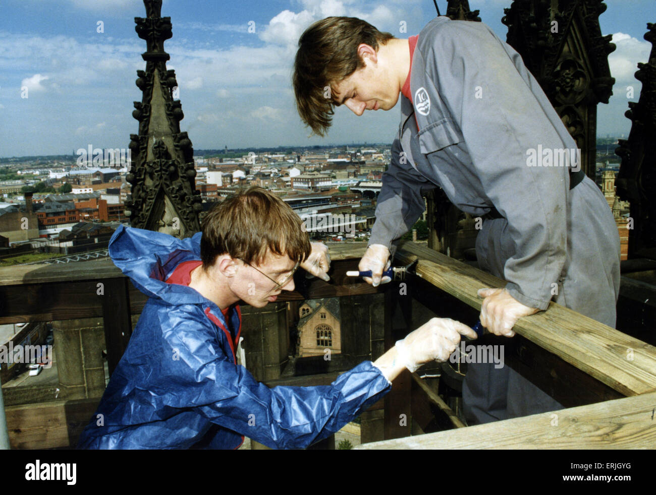 Chris Armstrong (left) and Carney Edwards strip and creosote the safety rails around the flagpole on the top of - Stock Image