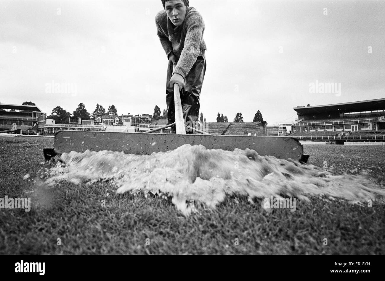 Groundsman Ian Guys tries to clear the water from the pitch at Edgbaston ahead of the third test match between England - Stock Image