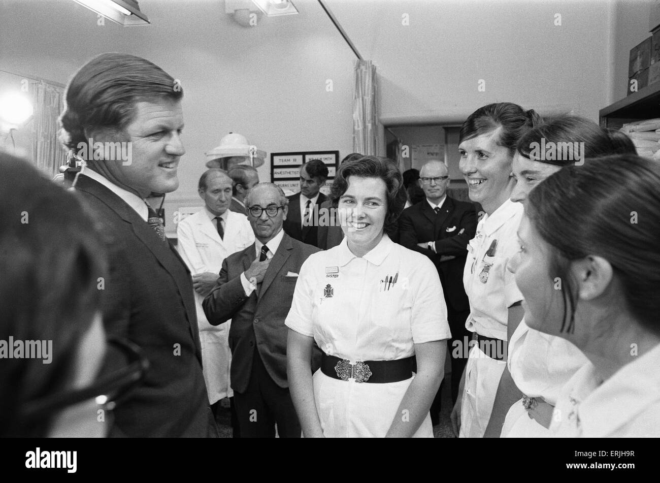 Senator Edward Kennedy seen here speaking to Sister Maureen Rouse (centre) at the Birmingham Accident Hospital. - Stock Image