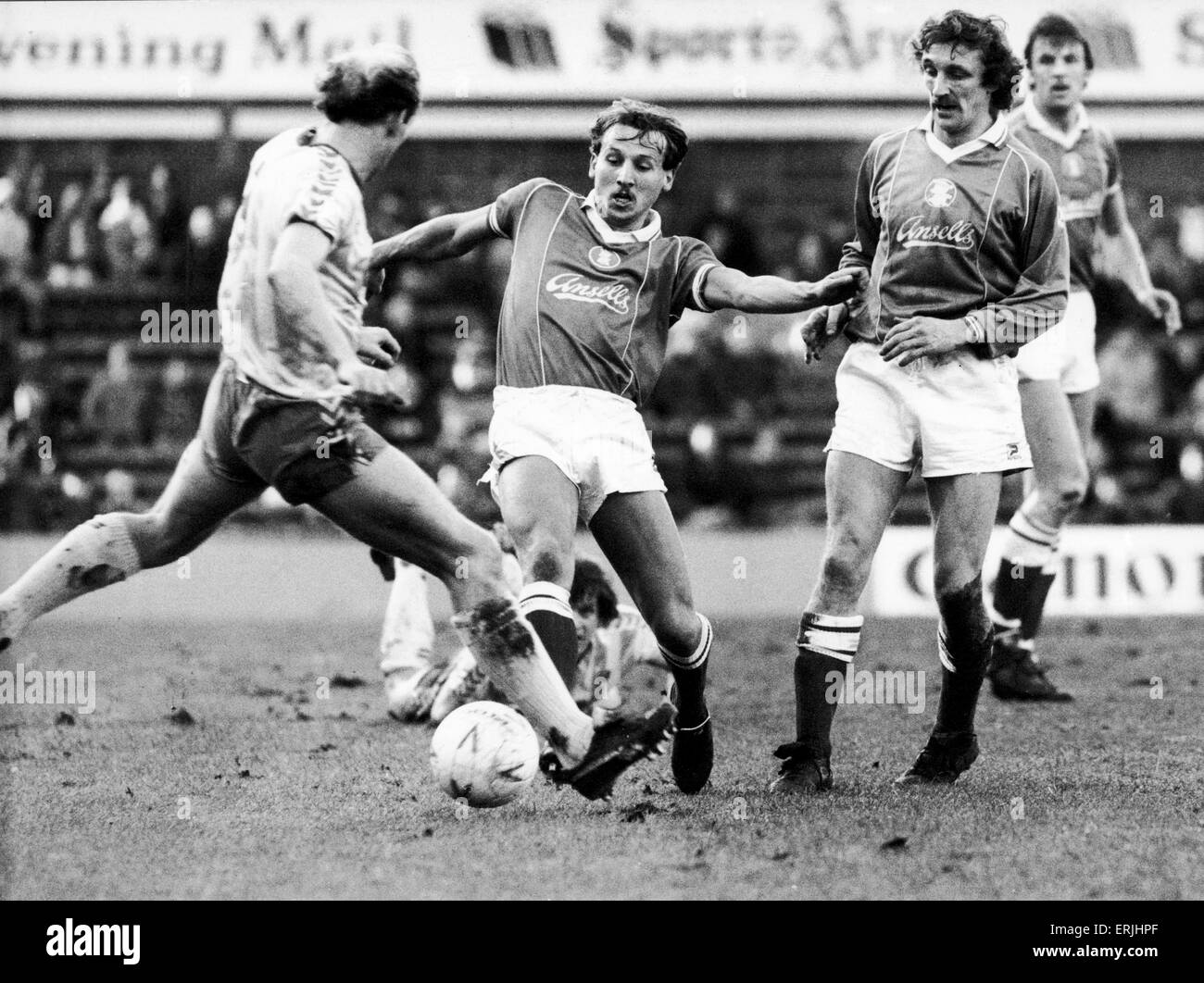 Birmingham City footballer Robert Hopkins in action challenged by Nowrich City players Greg Downs as Des Bremner Stock Photo