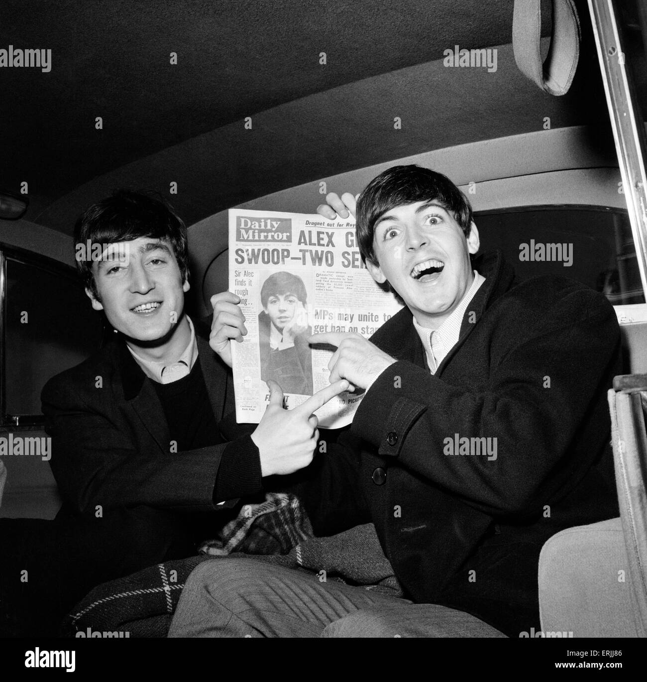 Paul makes the front page, John Lennon & Paul McCartney with copy of Daily Mirror Newspaper. 13th November 1963. - Stock Image