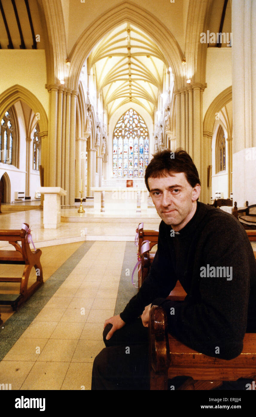 Father Brendan Curley, Administrator at Salford Cathedral, Manchester. 7th June 1990. The Cathedral Church of St. - Stock Image