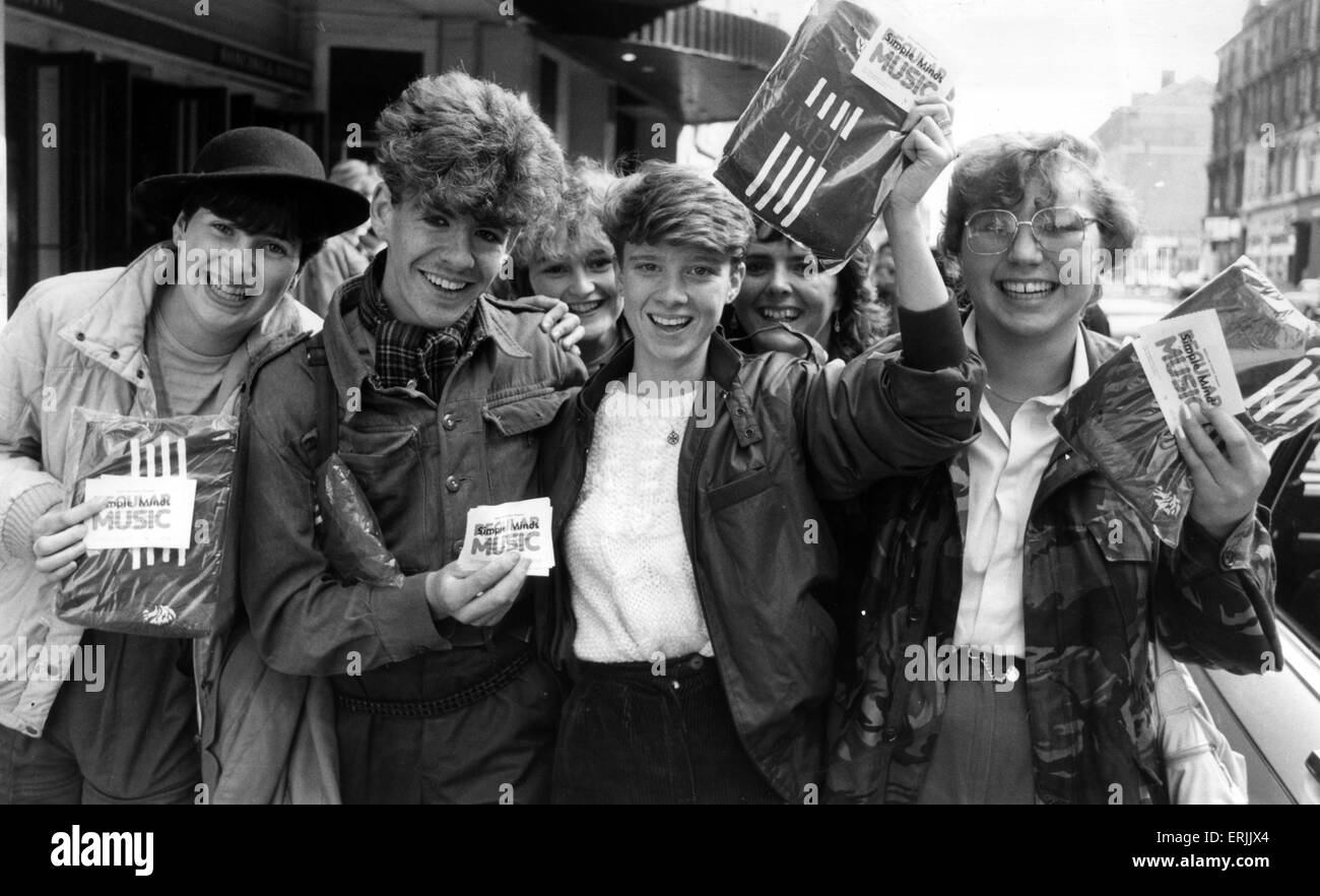 Fans of Simple Minds, Rock Group, celebrate after managing to purchase tickets for their  upcoming Scottish concerts - Stock Image