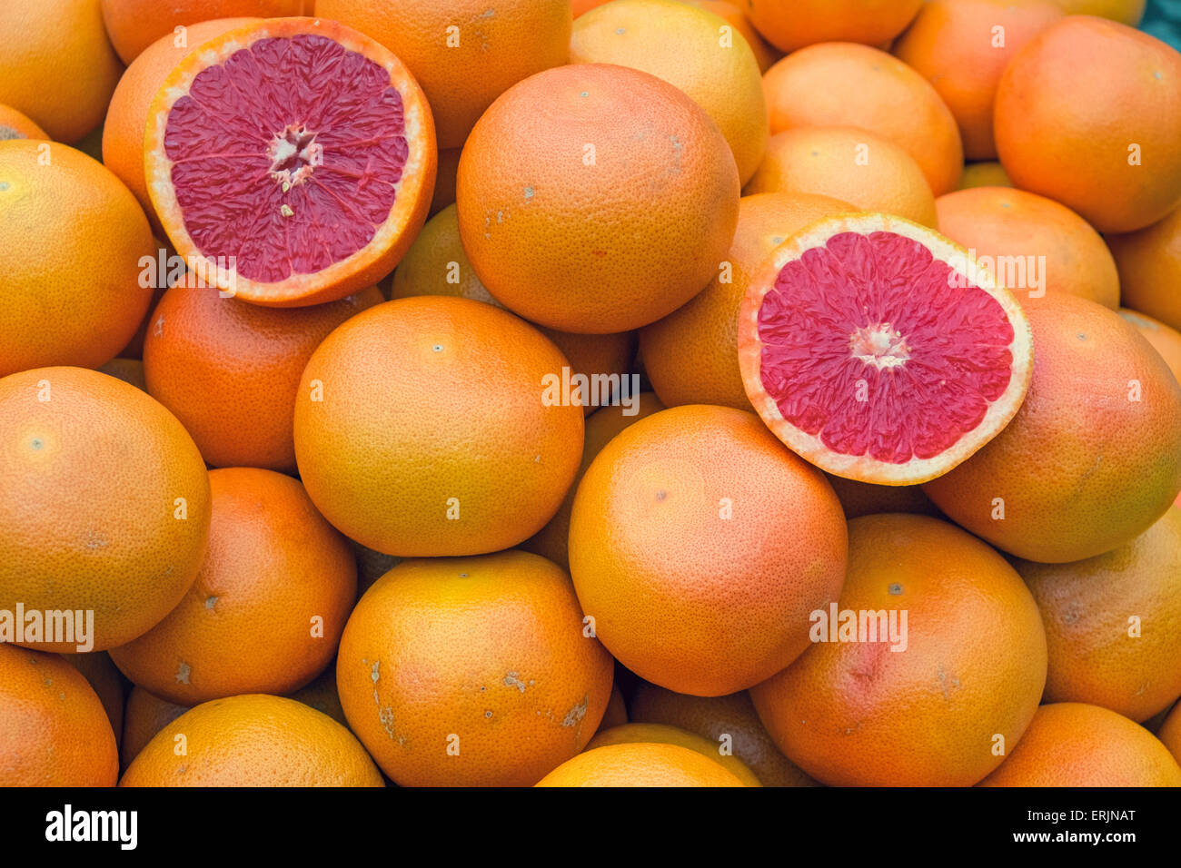 Ripe blood oranges for sale on a market - Stock Image