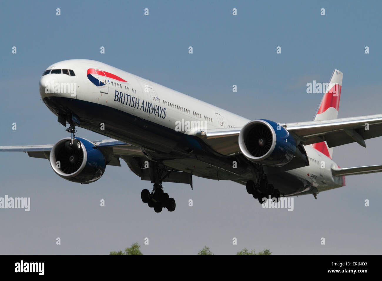 British Airways Boeing 777-300ER twin-engine long-haul commercial jet plane on approach to London Heathrow. Closeup - Stock Image