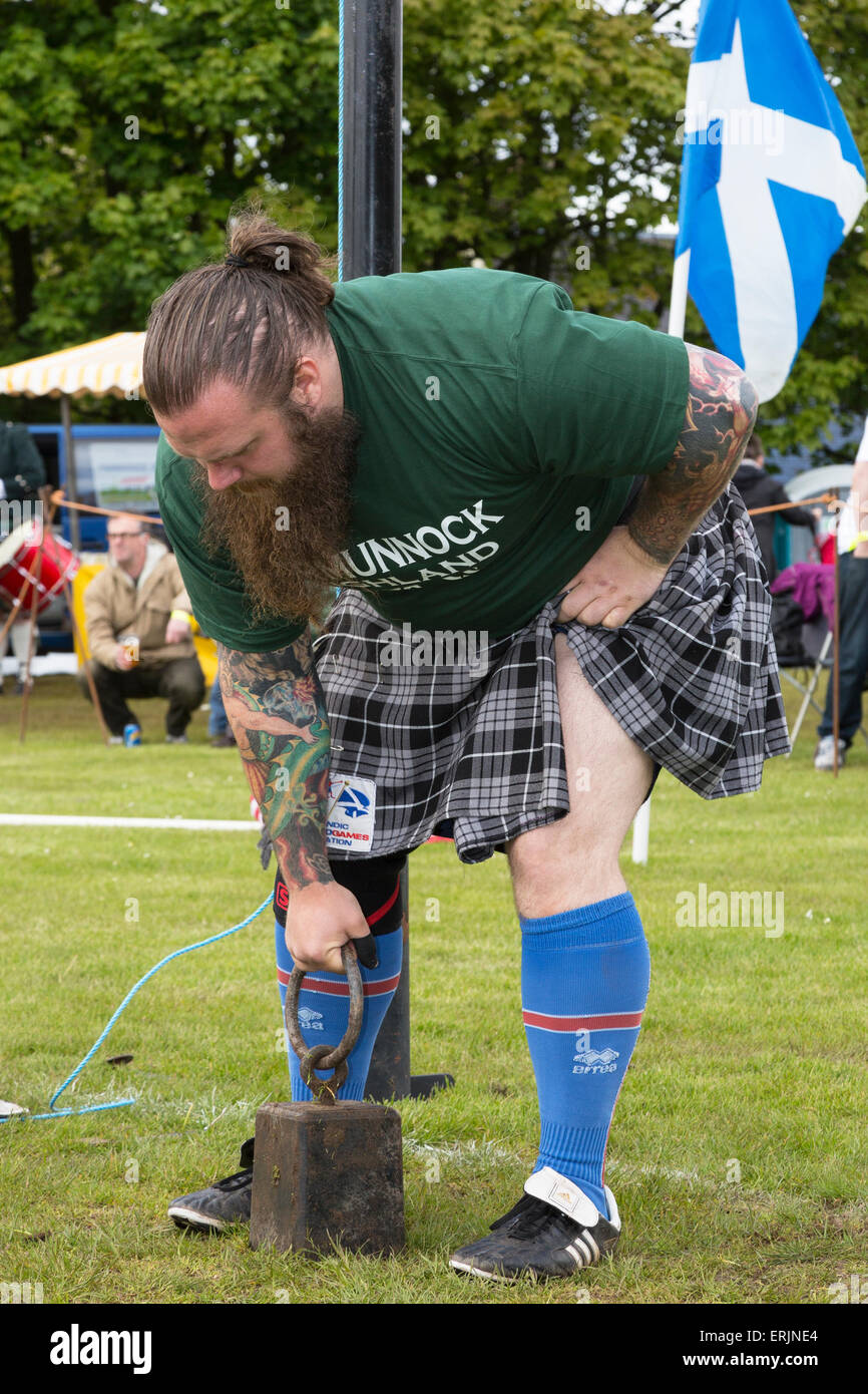 Competitor at the Carmunnock Highland games preparing to throw the 28 pound weight over the high bar, Carmunnock - Stock Image