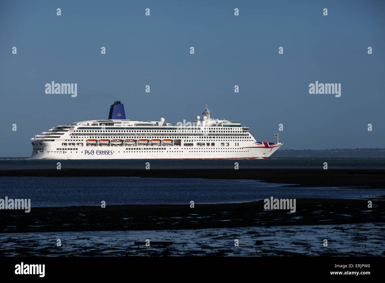 P&O Cruise Ship Aurora pictured with her new livery Union Jack logo leaving Southampton - Stock Image