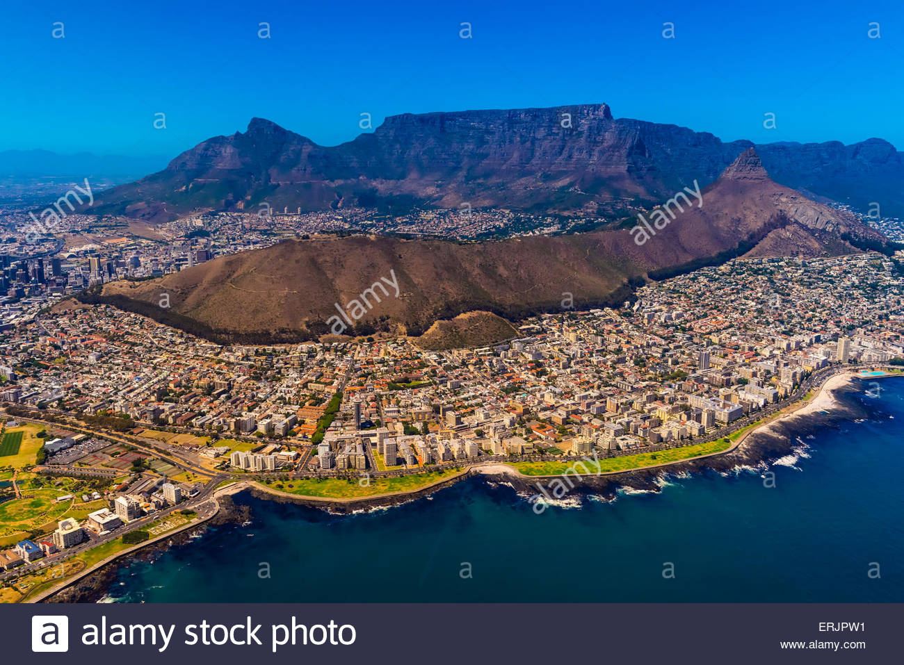 Aerial view of coastline of Cape Town with Signal Hill and Table Mountain in background, South Africa. - Stock Image