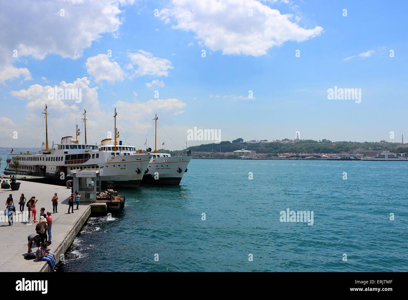 Ferryboats in Karakoy dock, Golden Horn. Topkapi Palace can be seen in the background. - Stock Image