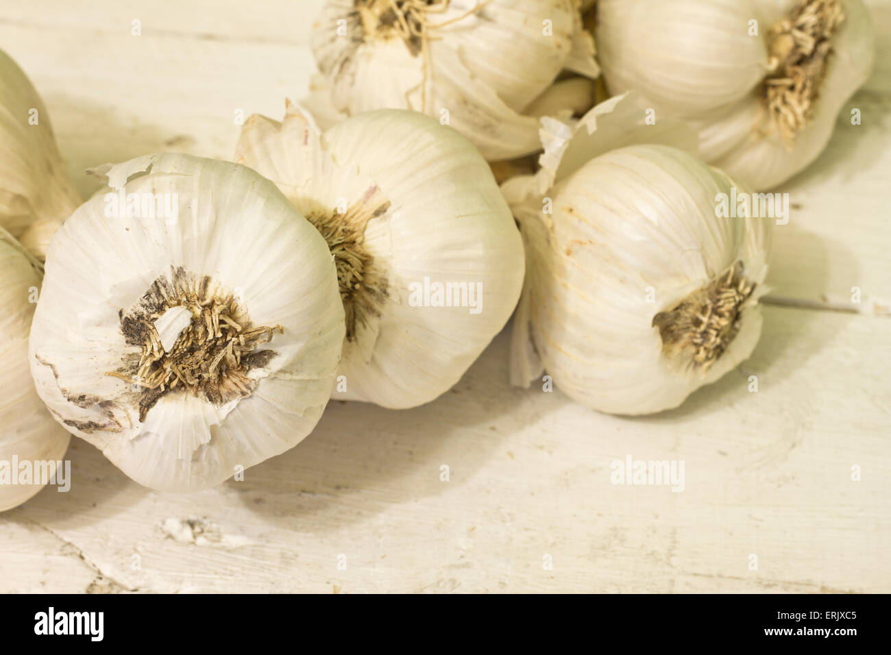 Group of garlic on wooden table - Stock Image
