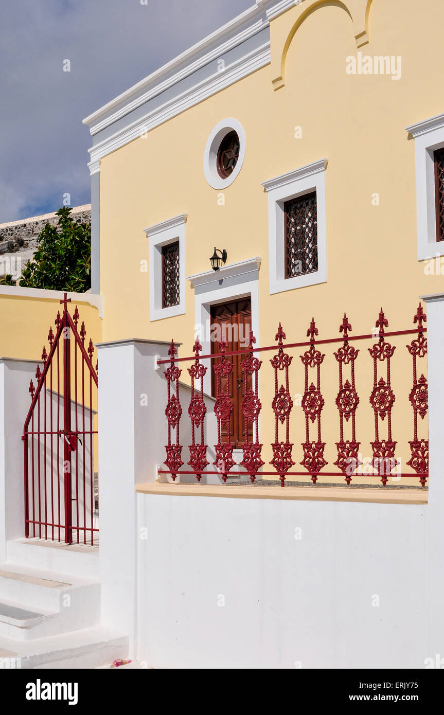 A Yellow House With Red Door, Gate And Railing; Fira, Santorini, Cyclades,  Greek Islands, Greece