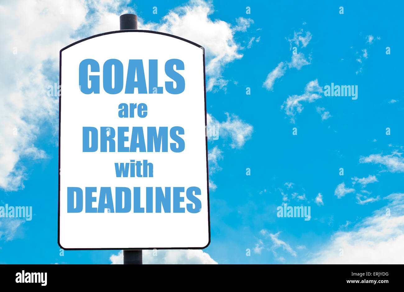 Goals Are Dreams with Deadlines  motivational quote written on white road sign isolated over clear blue sky background. - Stock Image