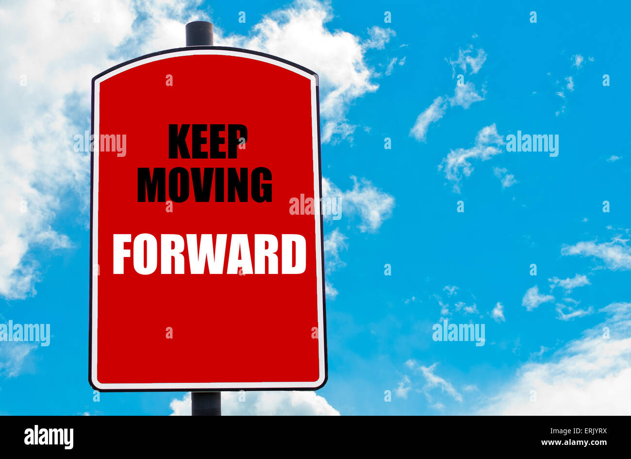 Keep Moving Forward  motivational quote written on red road sign isolated over clear blue sky background. - Stock Image