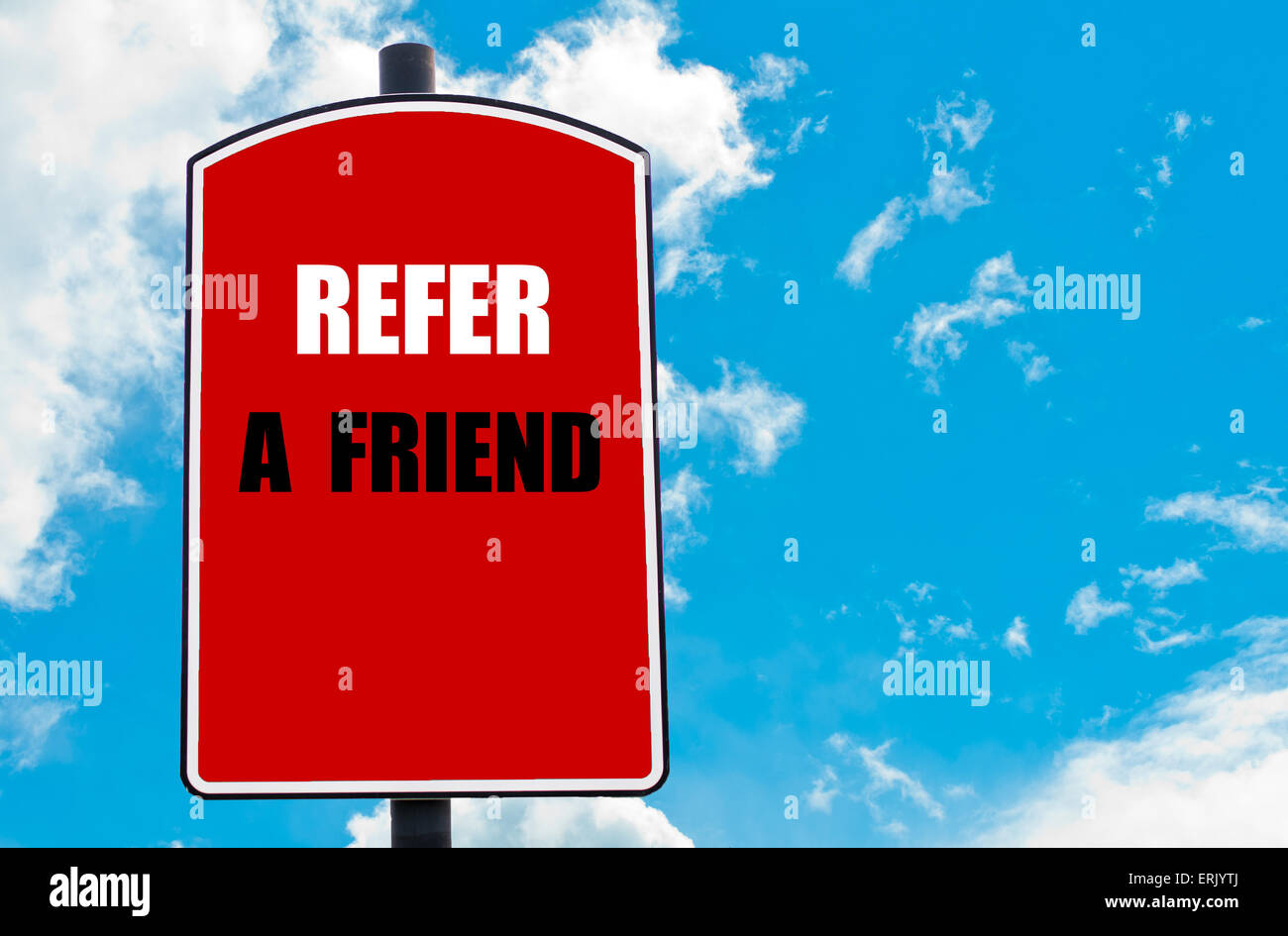Refer a Friend motivational quote written on red road sign isolated over clear blue sky background. - Stock Image