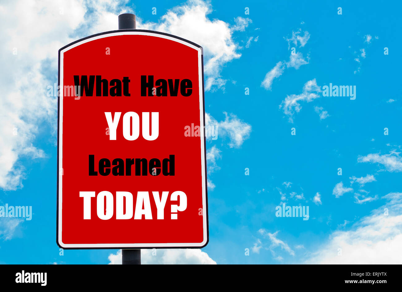 What Have You Learned Today? motivational quote written on red road sign isolated over clear blue sky background. - Stock Image
