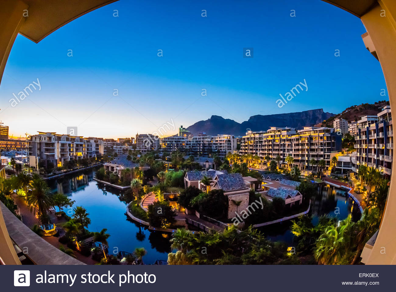 View from balcony at sunrise with apartment buildings and Table Mountain in background, Hotel One&Only Cape - Stock Image