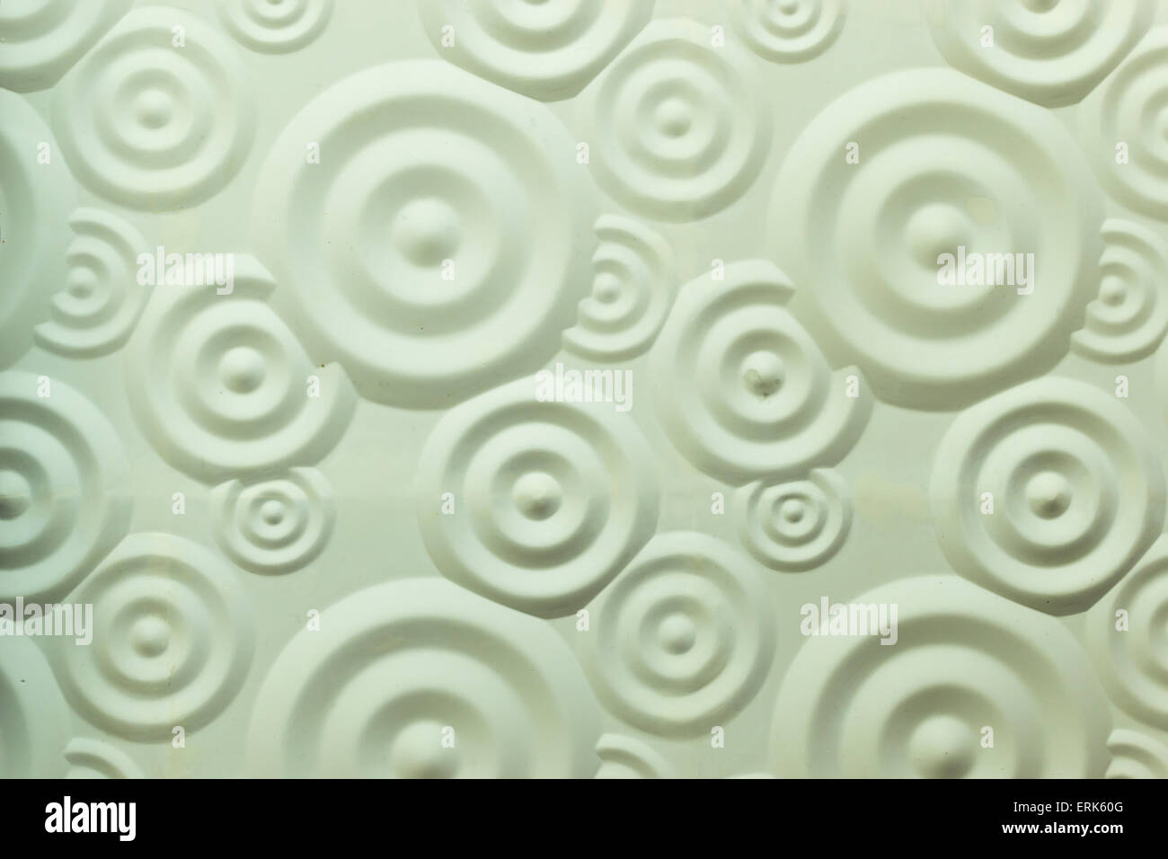 Sprial brick wall decoration in white cement and plaster - Stock Image
