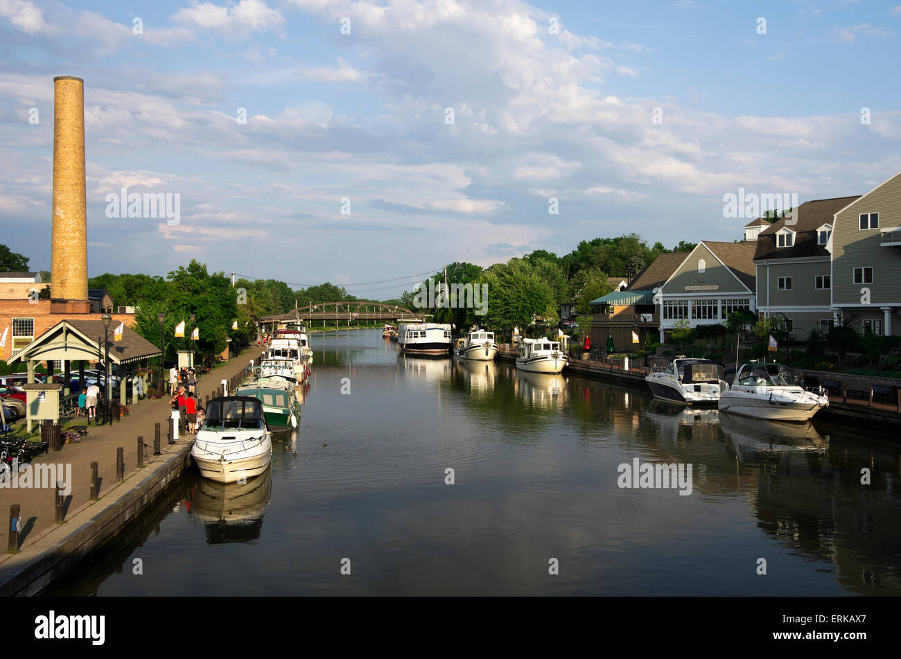 Small private and charter boats tied up along canal wall, looking East; Fairport, New York, United States of America - Stock Image