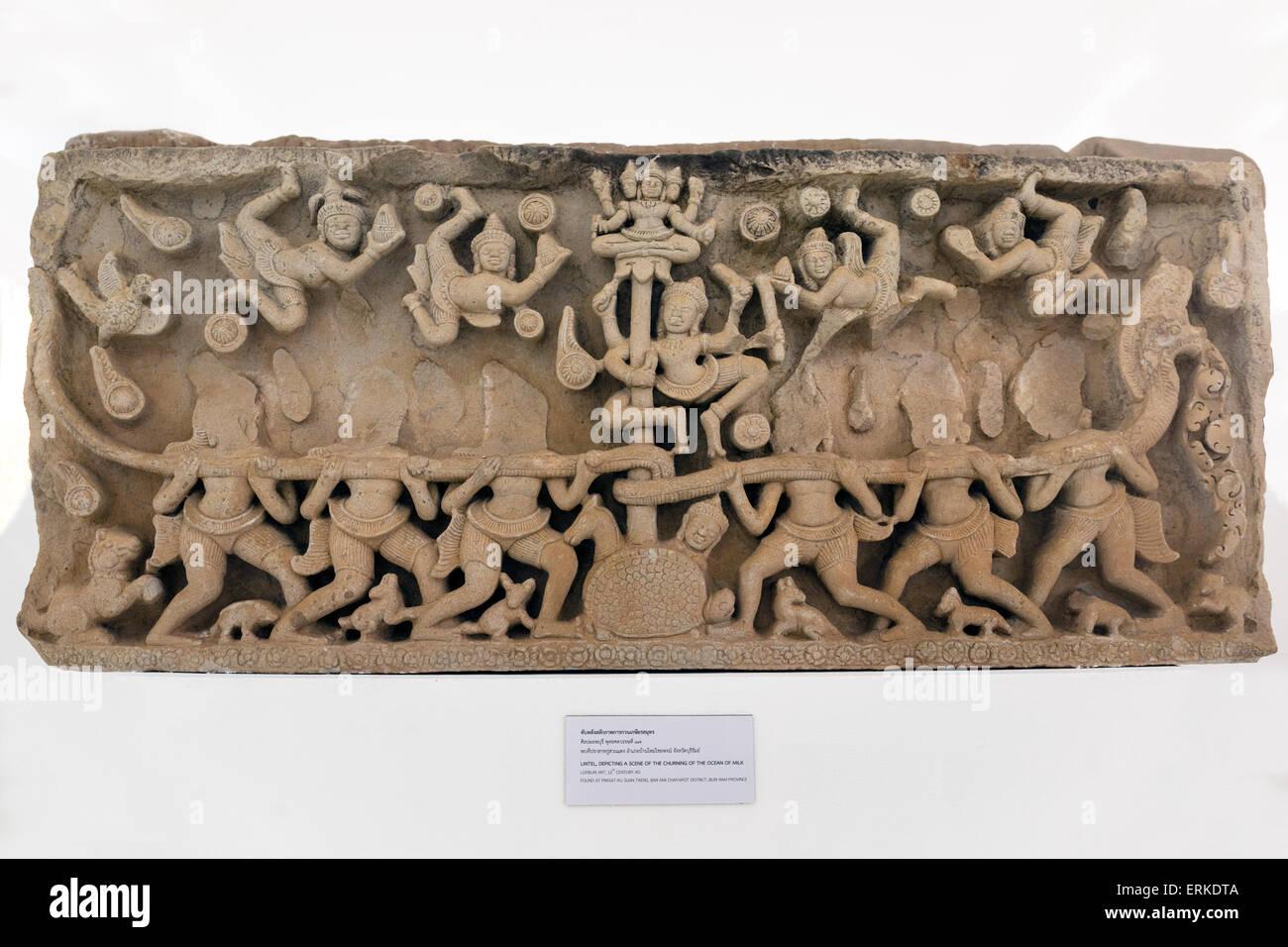 Lintel, depiction of the Churning of the Ocean of Milk, found at Prasat Ku Suan Taeng, Ban Mai, Phimai National - Stock Image