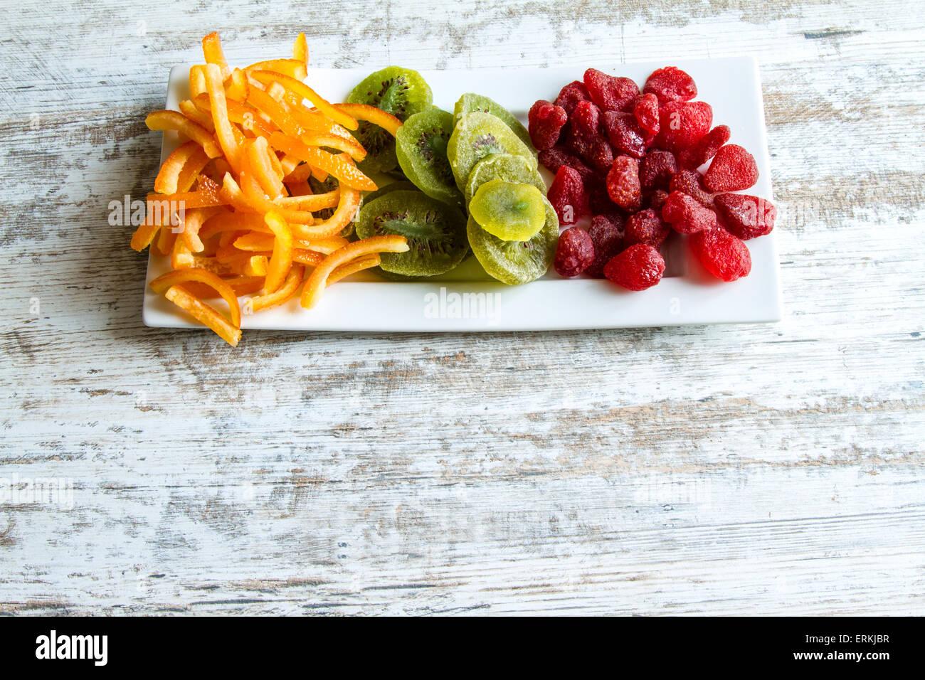 Orange, Kiwi and Strawberry on a plate - Stock Image