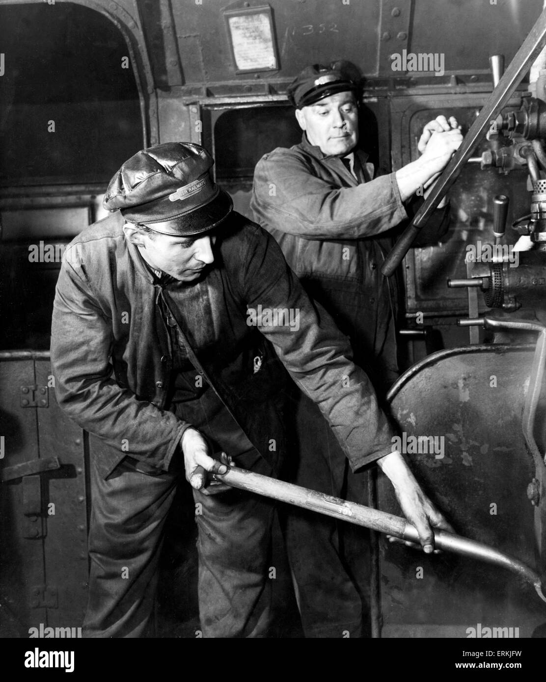 Engine driver and fireman at work on a British Railways locomotive, February 1954. - Stock Image