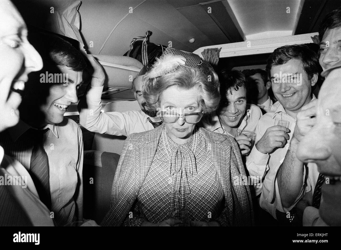 Margaret Thatcher British Prime Minister - December 1984 relaxes at an impromptu party on board the VC-10 plane - Stock Image