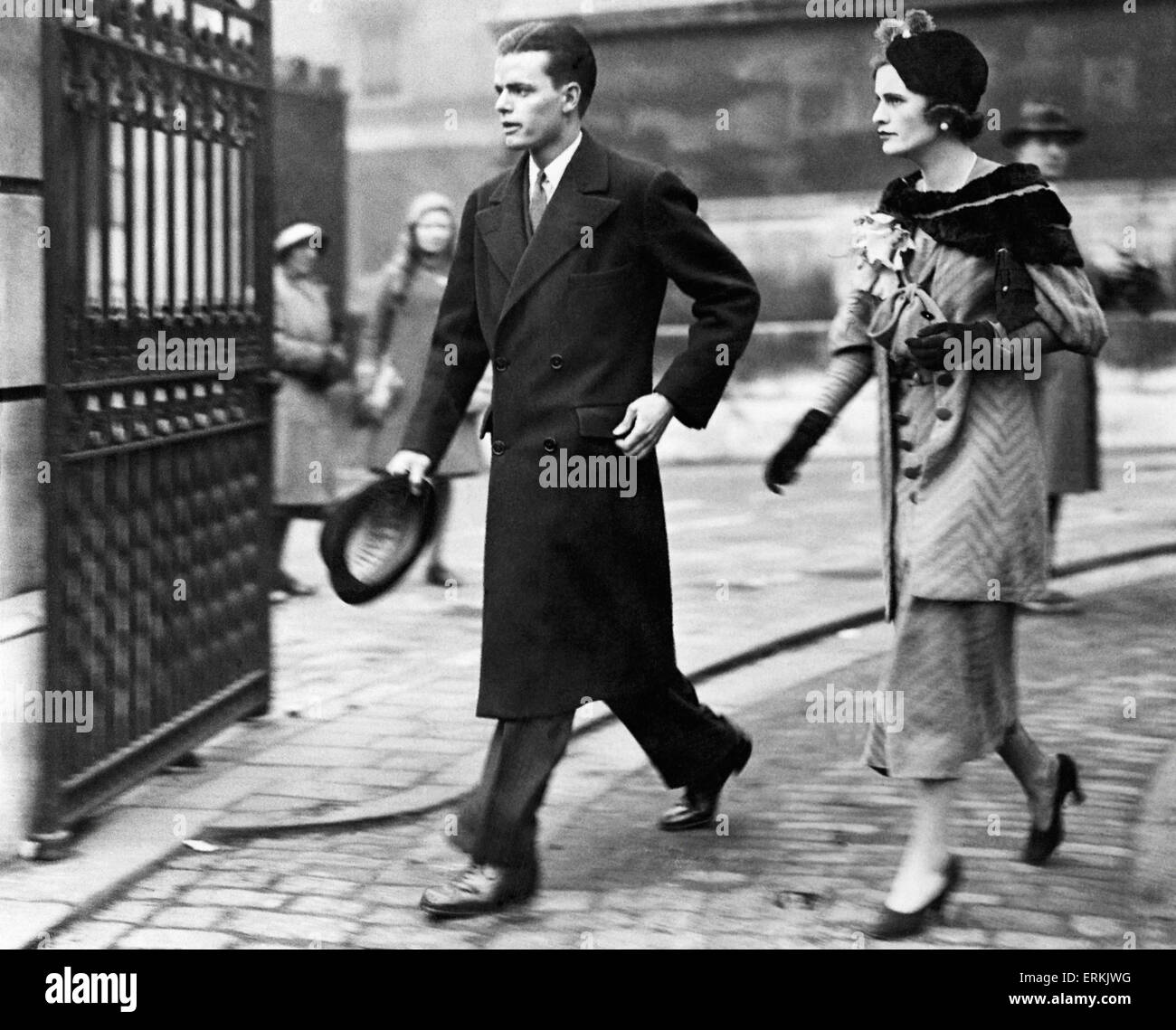 American golder and stockbroker Charles Sweeney and his fiancee Miss Margaret Whigham leaving Brompton Oratory after - Stock Image