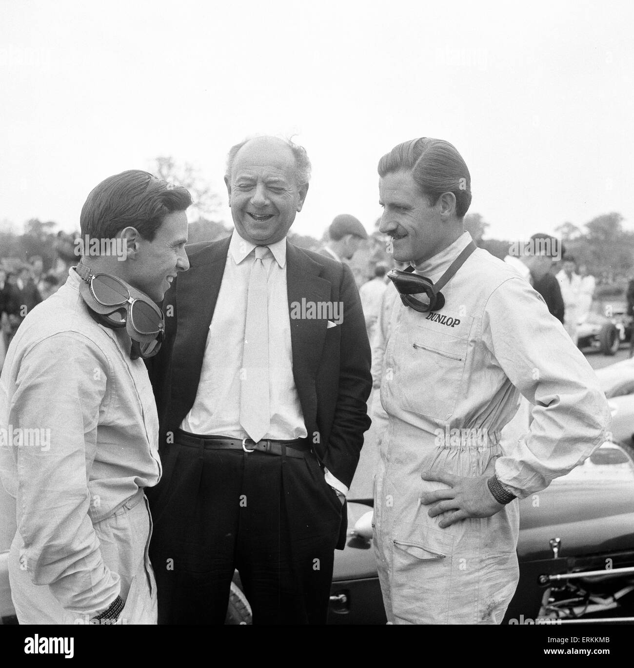 Raymond Mays, former racing driver and entrepreneur, pictured with Jim Clark & Graham Hill, at Racing Meeting, - Stock Image
