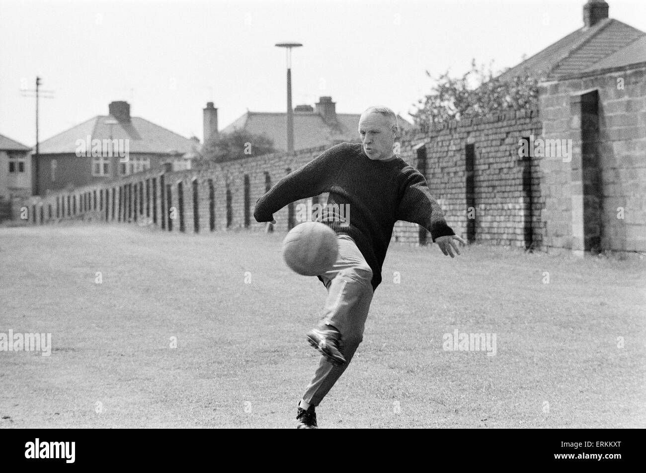 Liverpool manager Bill Shankly, aged 57,  keeps himself  fit by practicing his football skills at the club's - Stock Image