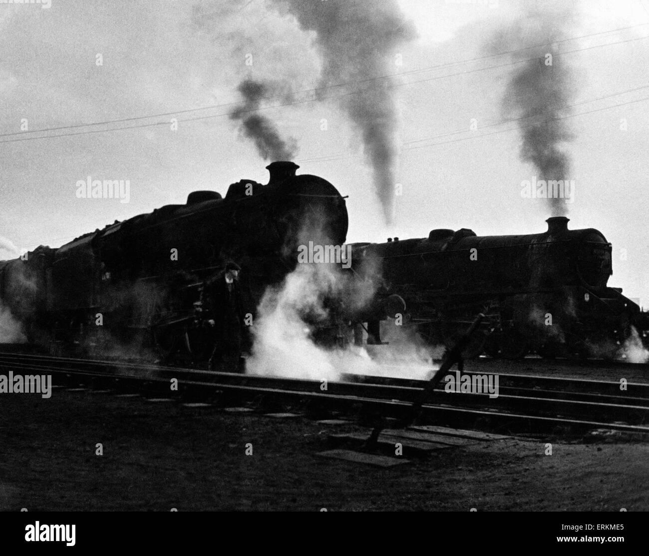 Steam locomotive engines steaming up on the tracks near Birmingham, circa 1960. - Stock Image