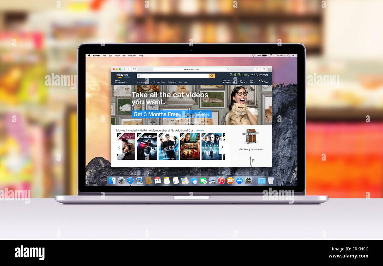 Amazon web page in Safari browser on the Apple 15 inch MacBook Pro Retina screen. Blurred shopping center on the - Stock Image