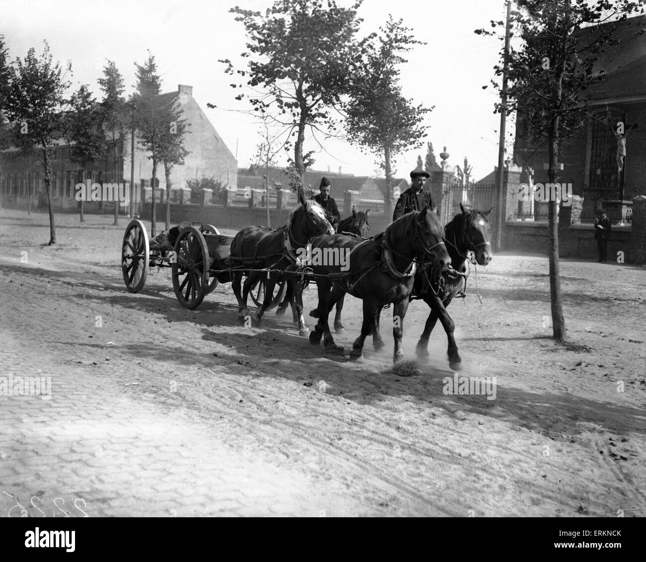 Belgian civilians help the Belgian military during the German advance by driving gun carriages. 8th September 1914 - Stock Image
