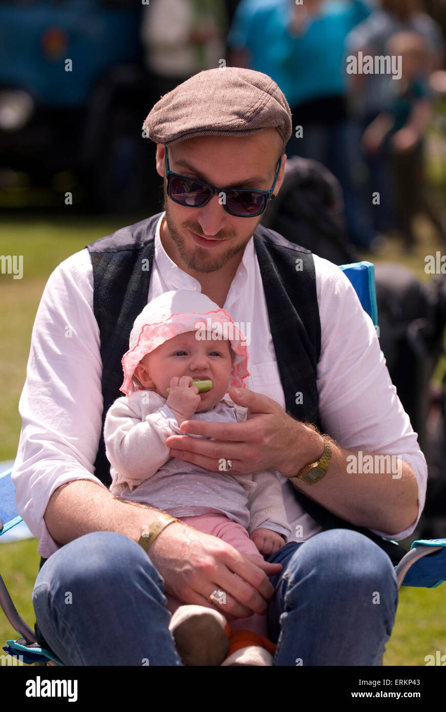Father with baby enjoying day out at the Milland Food, Drink & Music Festival 2015, Milland, Liphook, Hampshire, - Stock Image