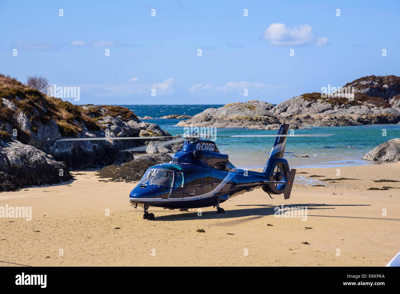 Helicopter landing on Ardtoe beach, Ardnamurchan Peninsula, Lochaber, Highlands, Scotland - Stock Image