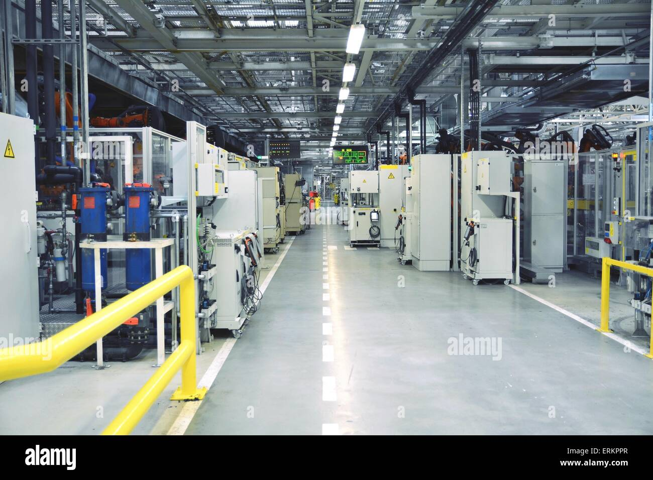 Industrial interior of the factory with computers and robots. - Stock Image