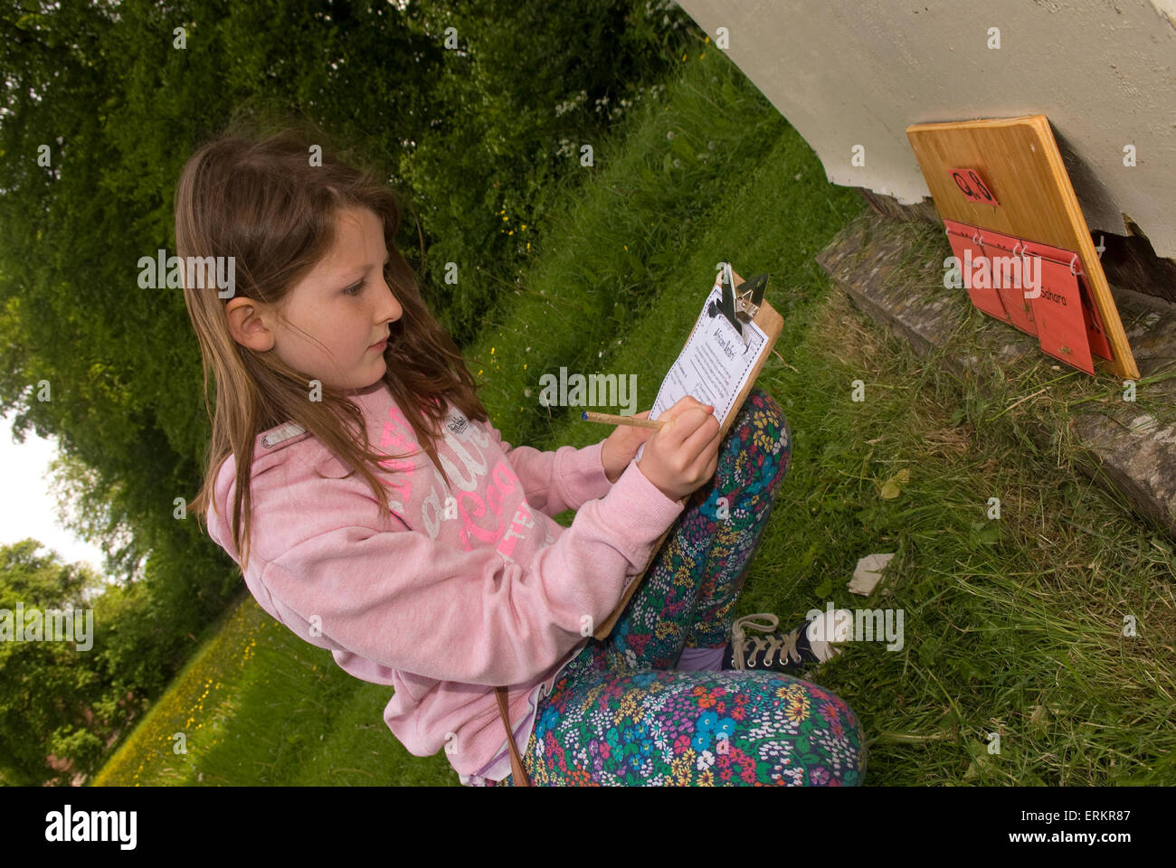 9 year old girl searching clues as she takes part in an African trail in search of the extinct Quagga (a type of - Stock Image