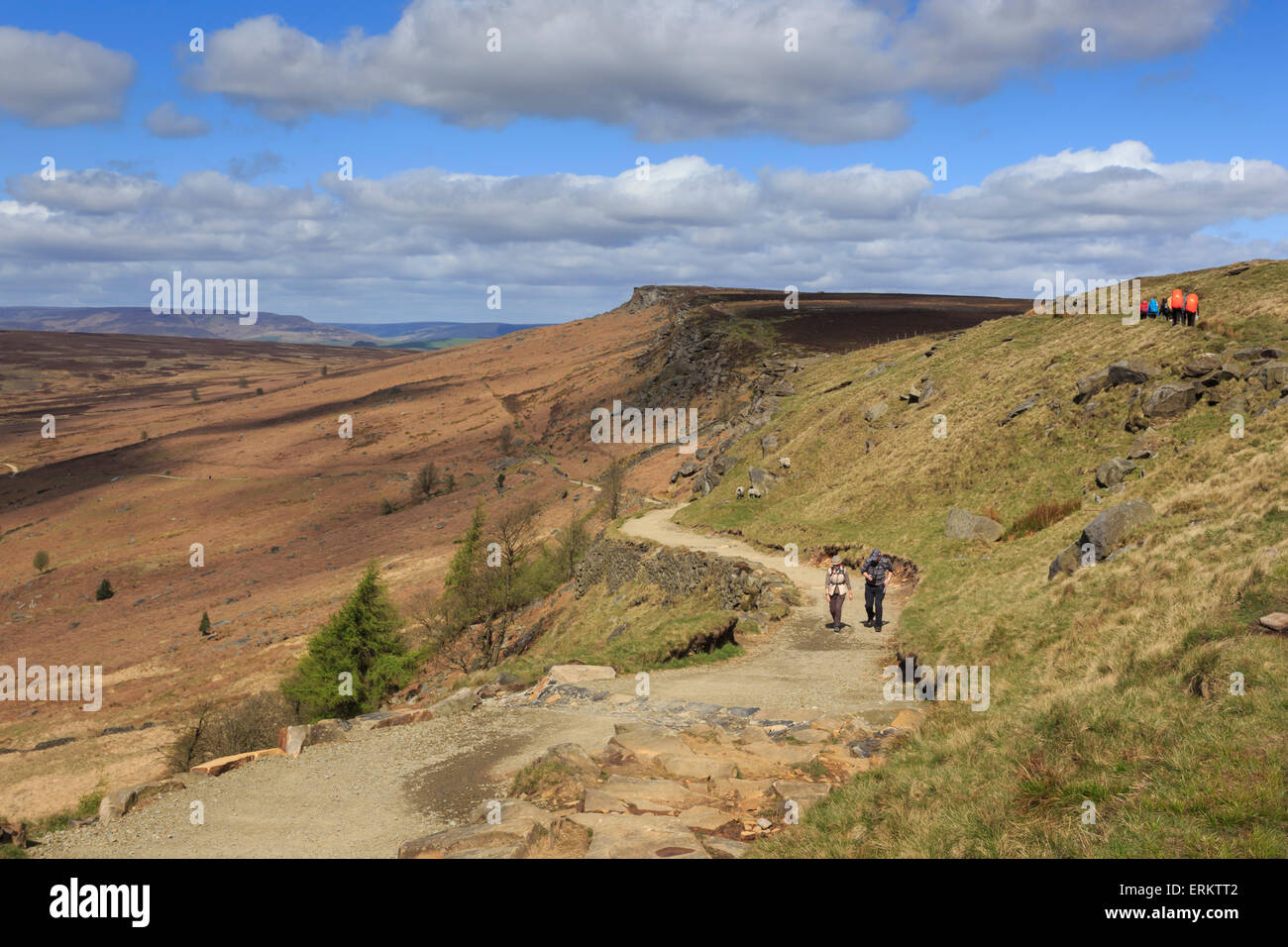 Walkers, Stanage Edge, on a fine spring day, near Hathersage, Peak District National Park, Derbyshire, England, - Stock Image