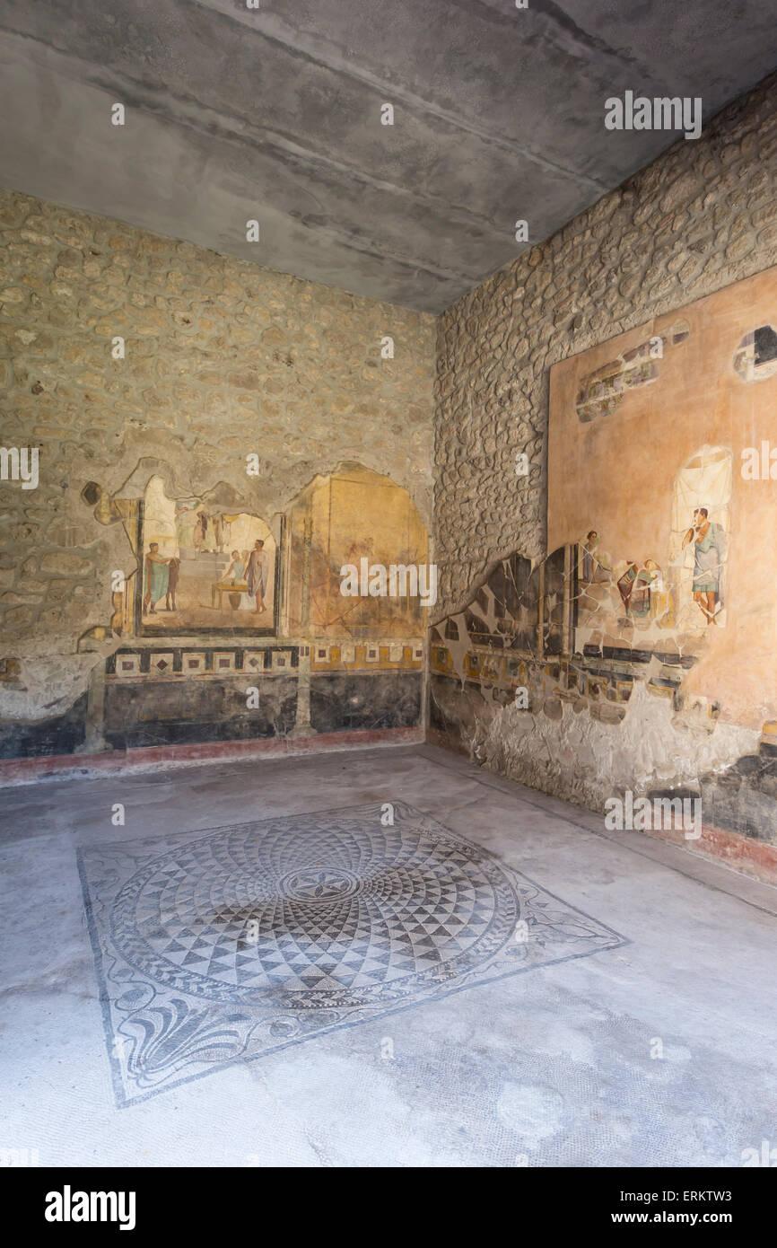 Public sitting room mosaic, frescoed walls in House of Amorini Dorati (Golden Cupids), Pompeii, UNESCO, Campania, - Stock Image