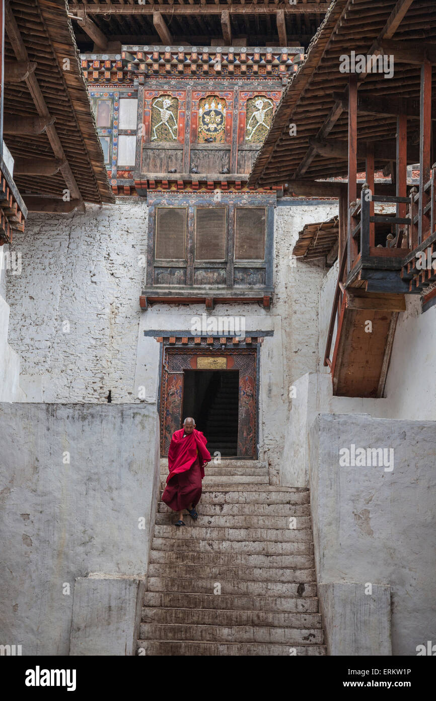 Tibetan monk comes out from Punakha Dzong, the second oldest and most majestic dzong in Bhutan, Asia - Stock Image