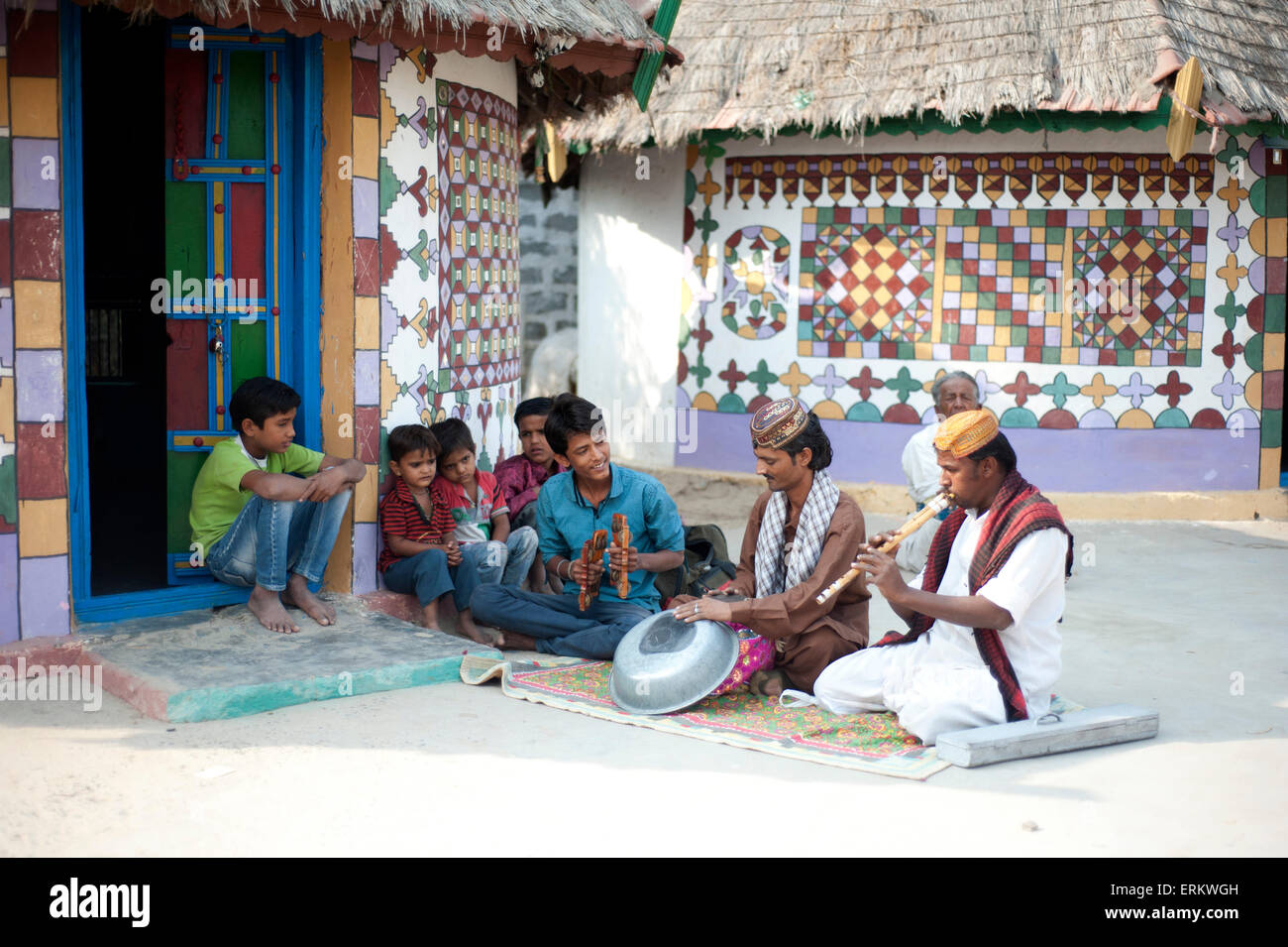 Village musicians, instruments made from metal bowl and terracotta water pot, Bhirindiara, Kachchh, Gujarat, India - Stock Image