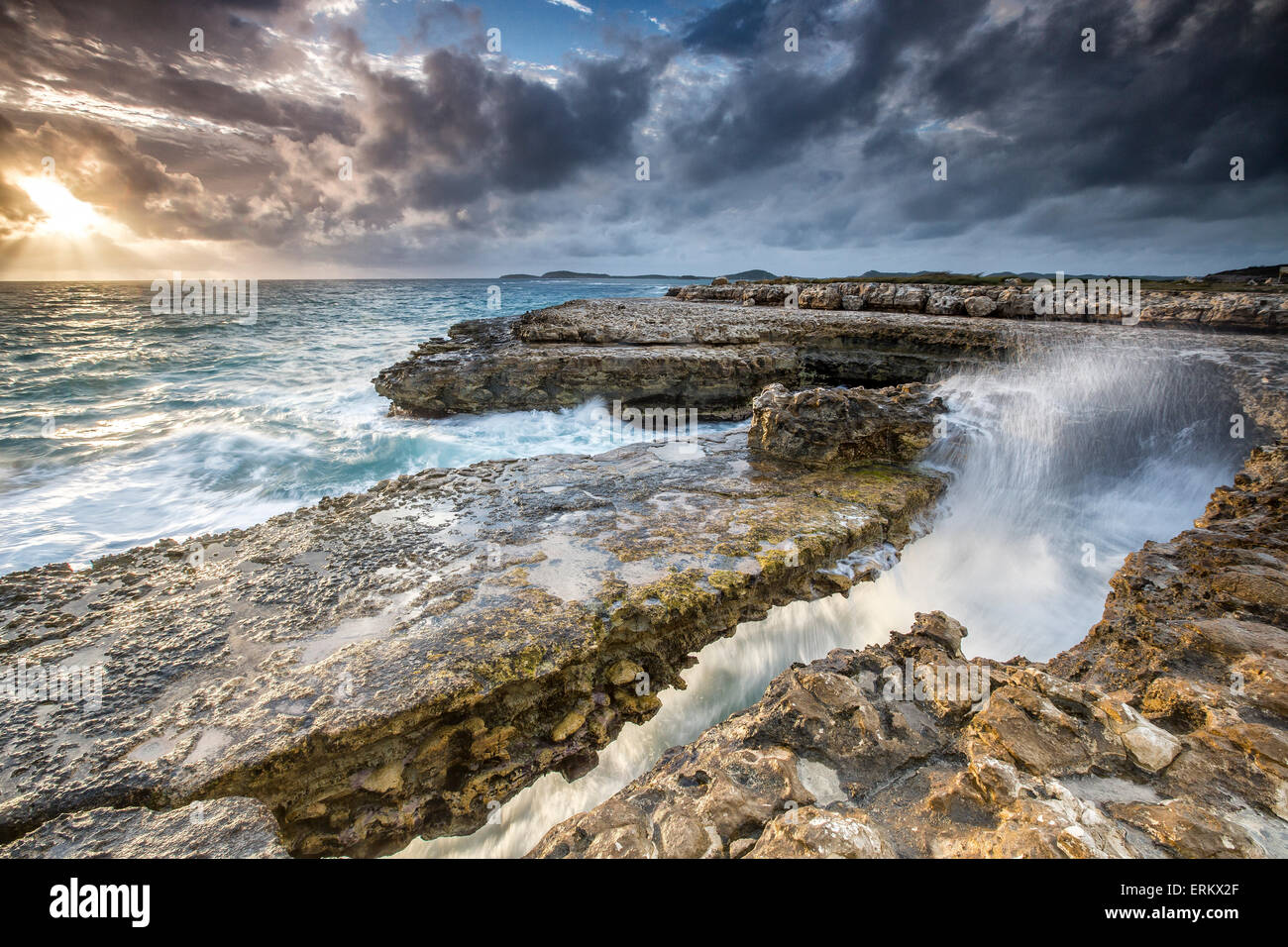 Rocks and crashing waves at Devil's Bridge, a natural arch carved by the sea, Antigua, Leeward Islands, West - Stock Image