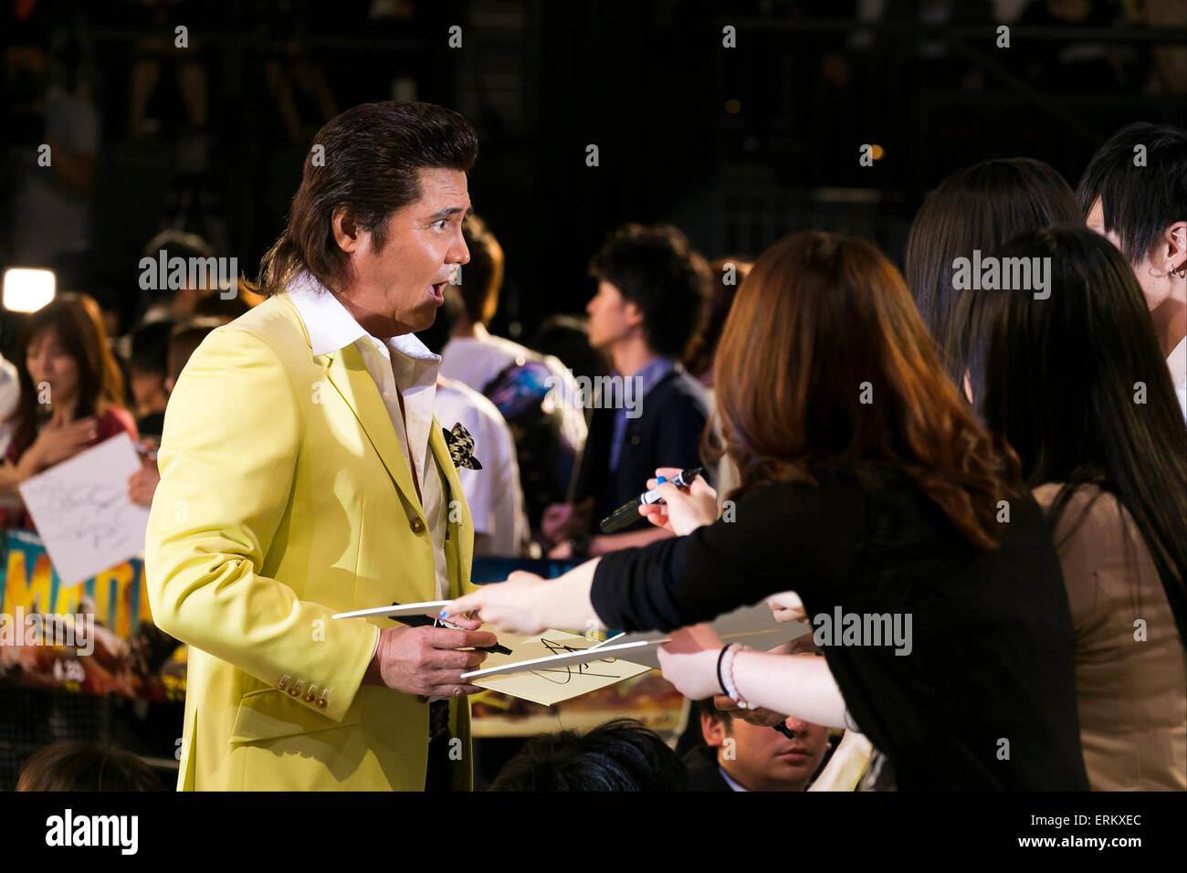 Actor Riki Takeuchi greets his fans during the Japan premiere for the film ''Mad Max: Fury Road'' - Stock Image