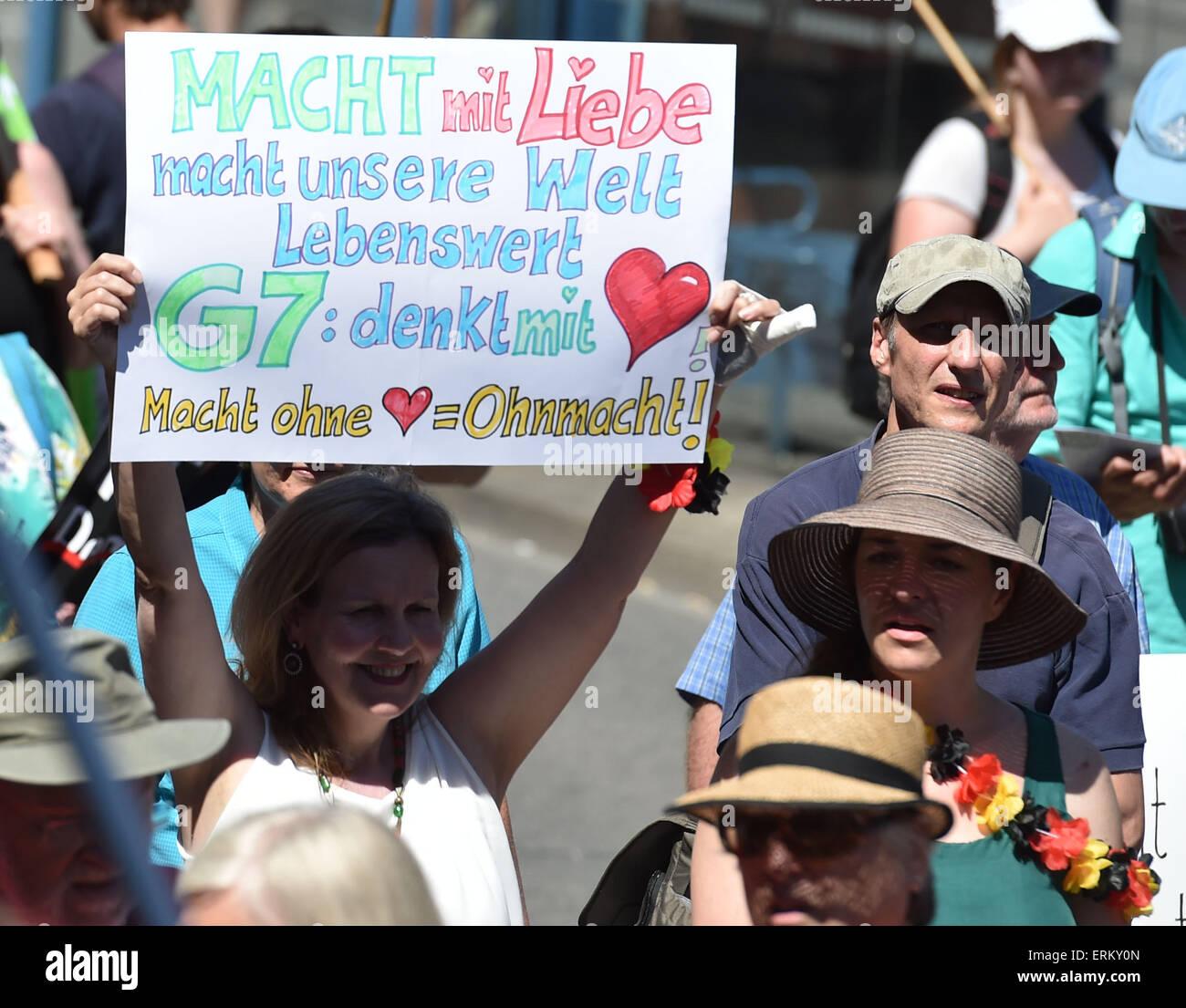 Munich, Germany. 04th June, 2015. Demonstrators hold a sign reading 'Macht mit Liebe - macht unsere Welt lebenswert; Stock Photo