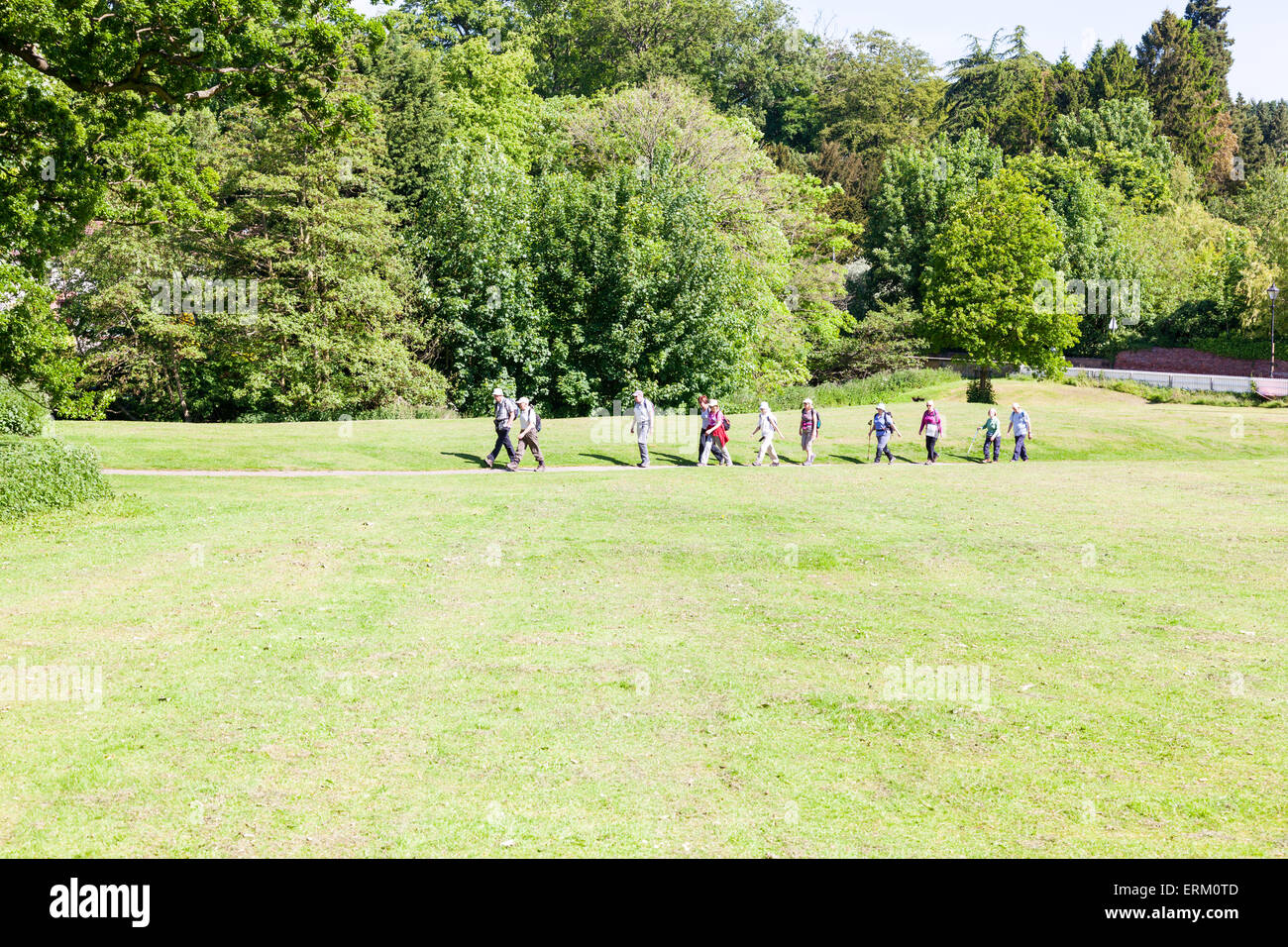 ramblers rambling walking in the countryside keeping fit in old age rural park UK England - Stock Image