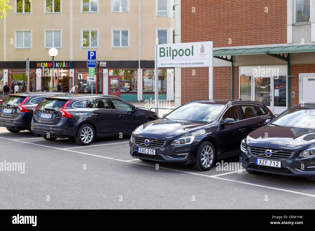Sunfleet carpool parking lot with environmentally friendly Volvo cars in town center, Lerum, Sweden.  Model Release: - Stock Image