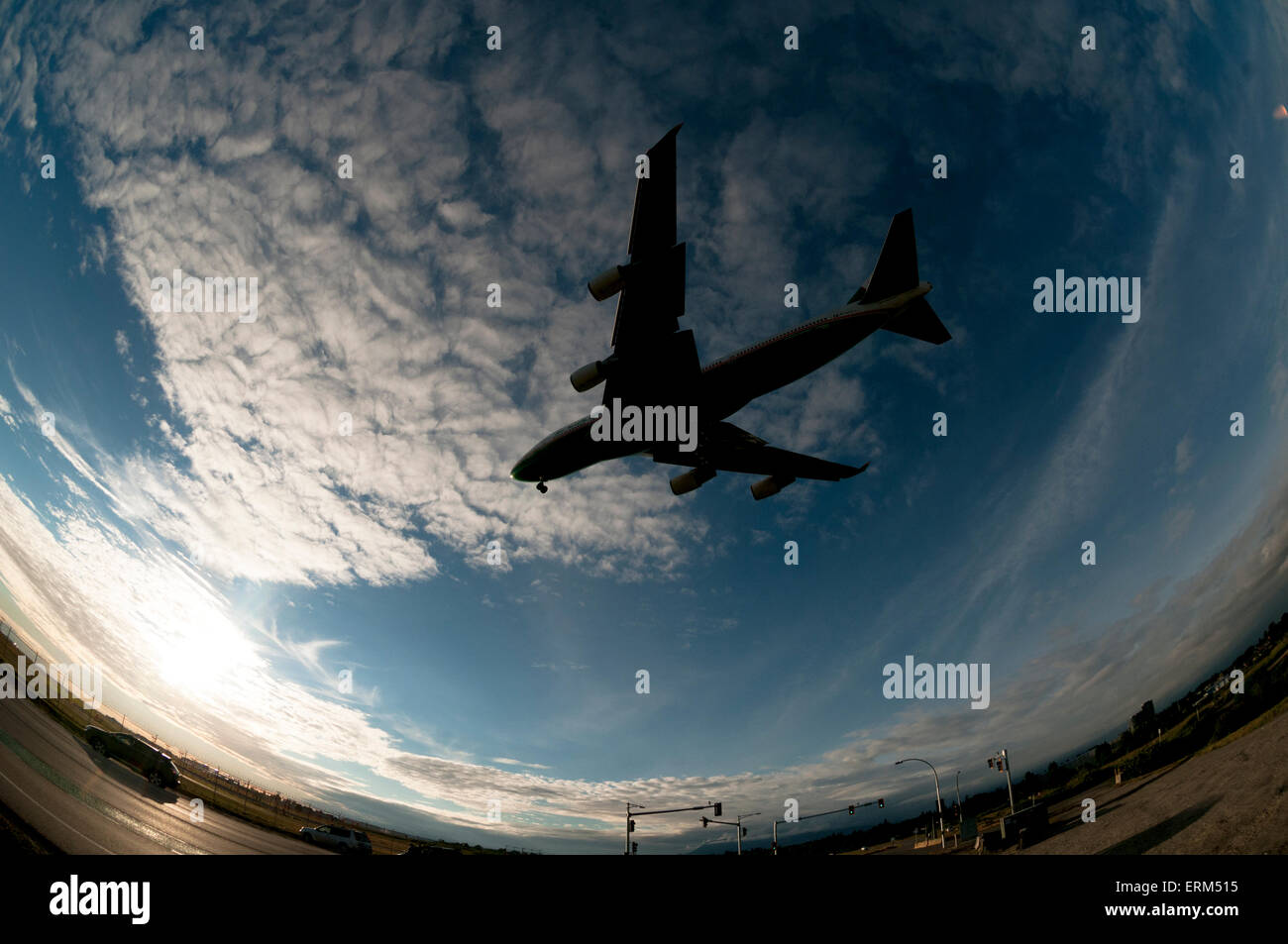 Large commercial jet on final approach - Stock Image