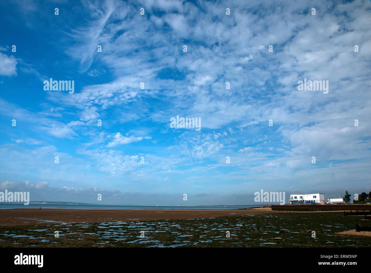 Dramatic Blue Sky at Meon Shore Hampshire, England - Stock Image