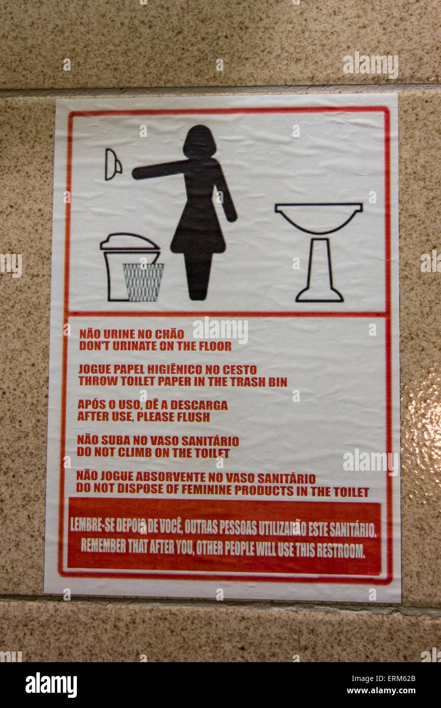 Amusing sign giving instructions for the use of a toilet in a restroom in Brazil - Stock Image