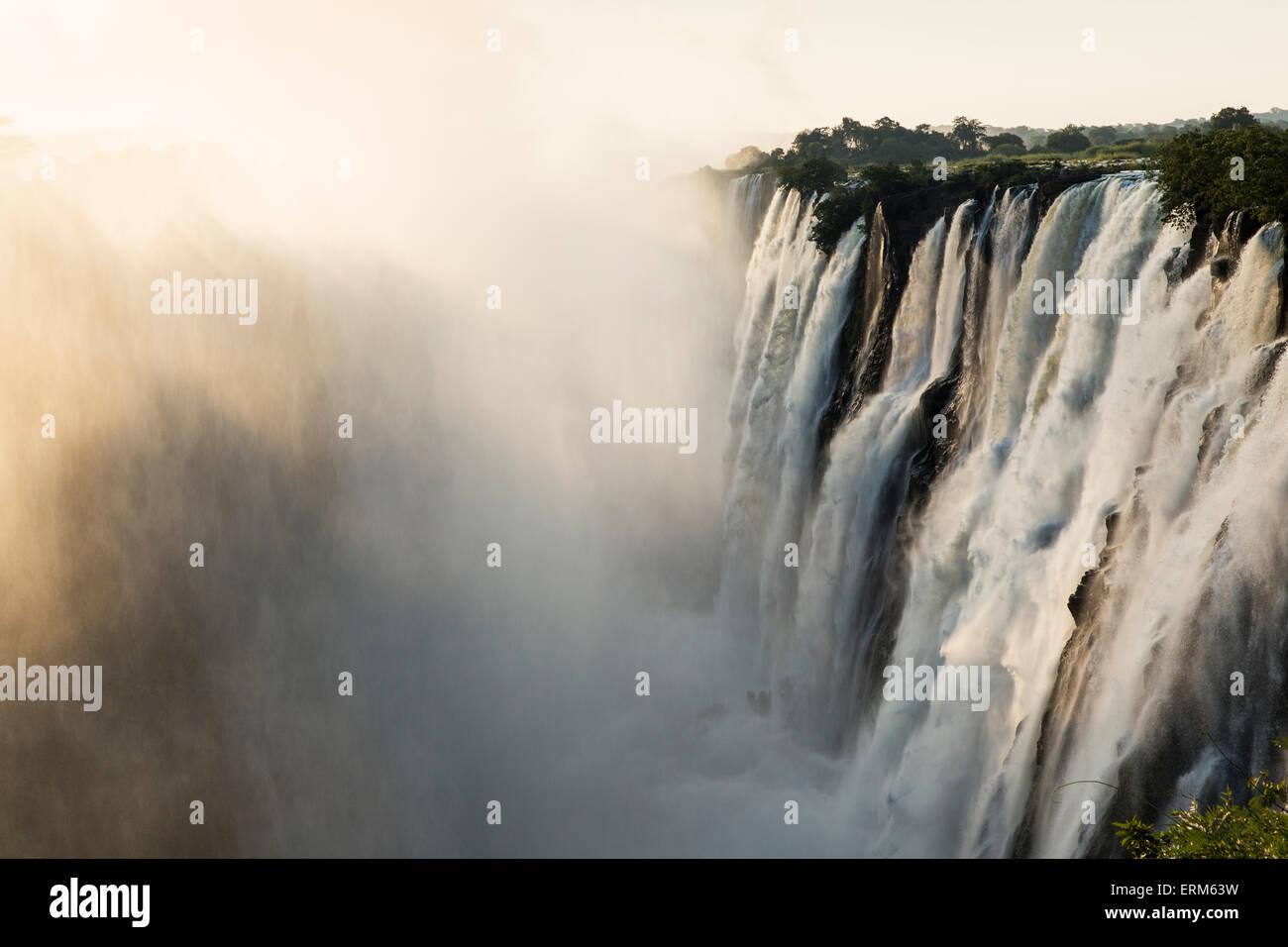 Africa, Zambia, Mosi-Oa-Tunya National Park,  Setting sun lights Eastern Cataract of Victoria Falls - Stock Image
